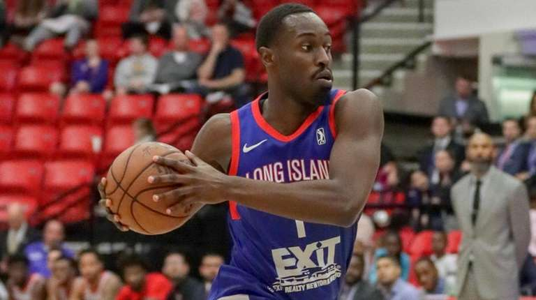 Long Island Nets forward Theo Pinson drives on
