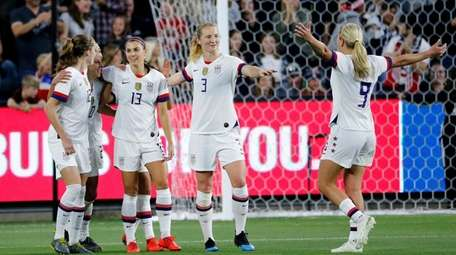 U.S. forward Alex Morgan (13) celebrates with teammates