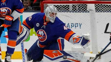 Robin Lehner #40 of the Islanders makes a