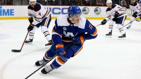 Mathew Barzal #13 of the Islanders skates against