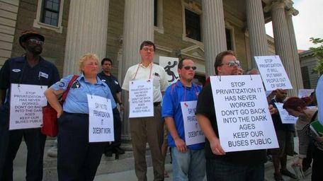Protestors rally as Nassau County Executive Edward P.