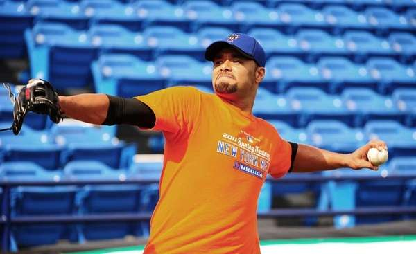 Johan Santana warms up his arm during a
