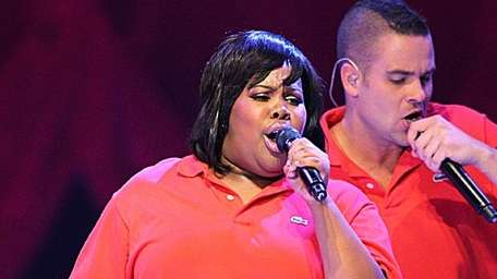 Amber Riley and Mark Salling perform at Glee