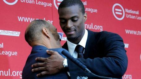 Plaxico Burress hugs former NFL coach Tony Dungy