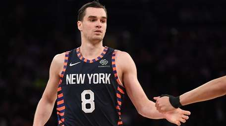 Knicks forward Mario Hezonja reacts with a teammate