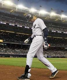 Derek Jeter of the New York Yankees walks