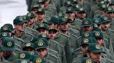 Iranian Revolutionary Guard members arrive for a ceremony