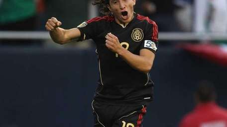 Andres Guardado of Mexico leaps in the air