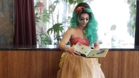Bella Noche reads to children during her first