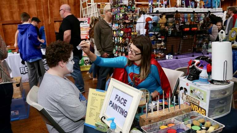 Vendors offer face painting at the Long Island