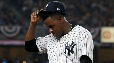 Luis Severino of the New York Yankees walks