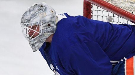 Islanders goaltender Robin Lehner looks on during hockey