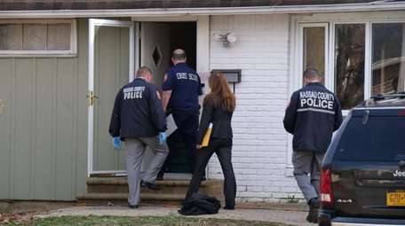 Nassau County police executed a search warrant Monday