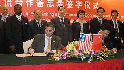 Levy signs sister-city agreement with officials in China.