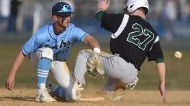 Phil Krpata #27 of Farmingdale, right, steals second