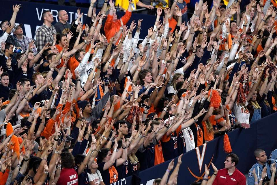 Virginia Cavaliers fans cheer on their team against