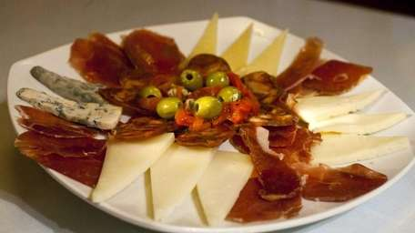 A cured meats and cheese platter, an appetizer