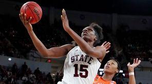 Mississippi State center Teaira McCowan shoots a layup