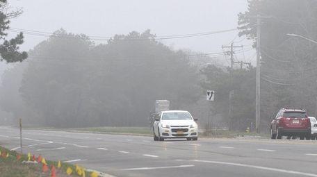 Fog along Horseblock Road in Medford on Tuesday
