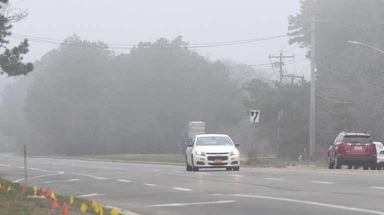 Fog along Horseblock Road in Medford on Tuesday
