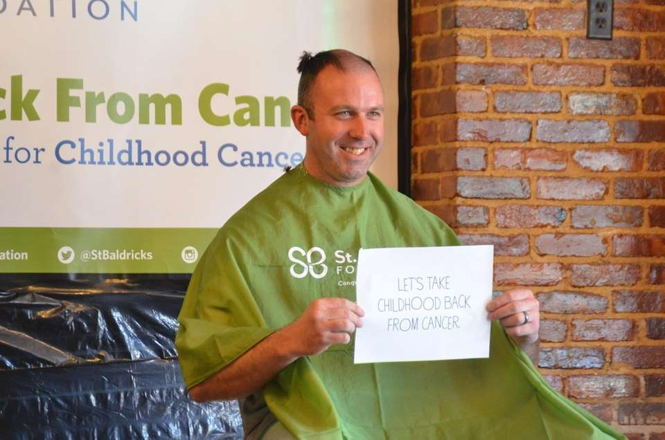 Locals get their heads shaved during the Three
