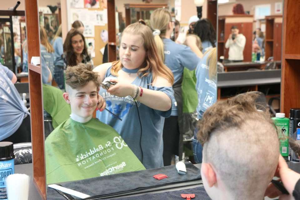 Students and faculty get their heads shaved to
