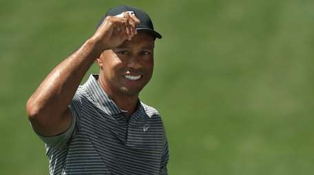 Tiger Woods looks on during a practice round