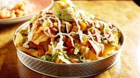 Vegetable nachos topped with melted cheese, pico de