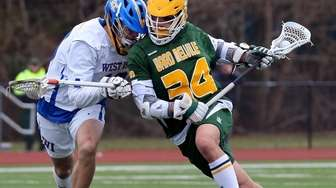 Ward Melville's Dylan Pallonetti drives to the net