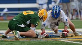 Ward Melville's Brandon Aviles wins the face off