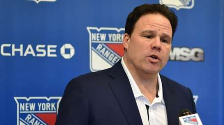 Rangers general manager Jeff Gorton speaks with the