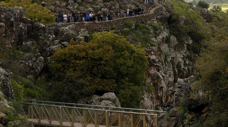 Tourists visit the Saar Falls in the Israeli-annexed