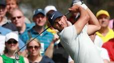 The patrons look on as Brooks Koepka hits