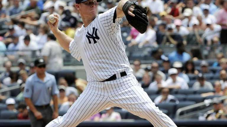 New York Yankees pitcher Brian Gordon delivers during