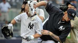 New York Yankees left fielder Brett Gardner (left)