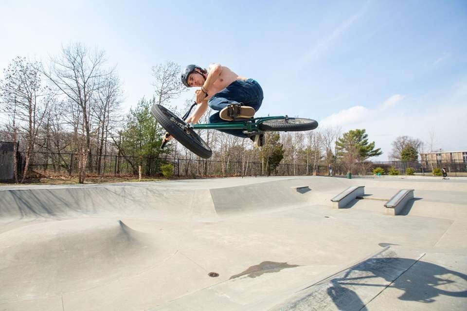Jason Barlow of Levittown, 34, executes a tabletop,