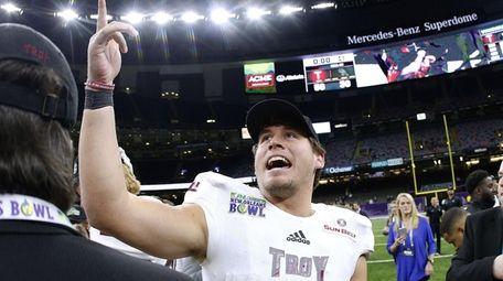 Troy quarterback Brandon Silvers celebrates after winning the