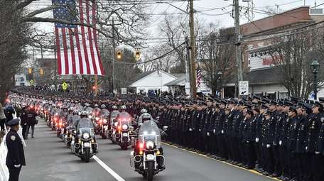 Officers lined Montauk Highway in Hampton Bays for