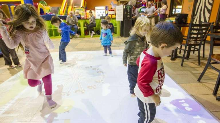 """Kids play on """"Motion Commotion"""" at Safari Adventure."""
