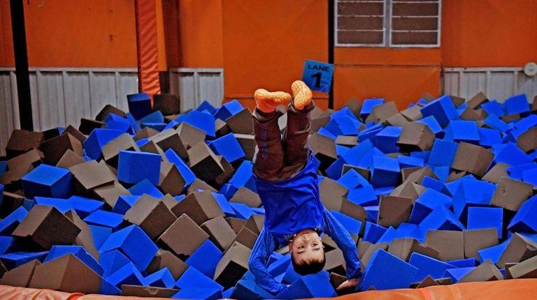 Tom Aliberti Jr., 7, leaps into the foam