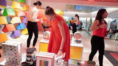 Shoppers browse the merchandise at Macy's Herald Square