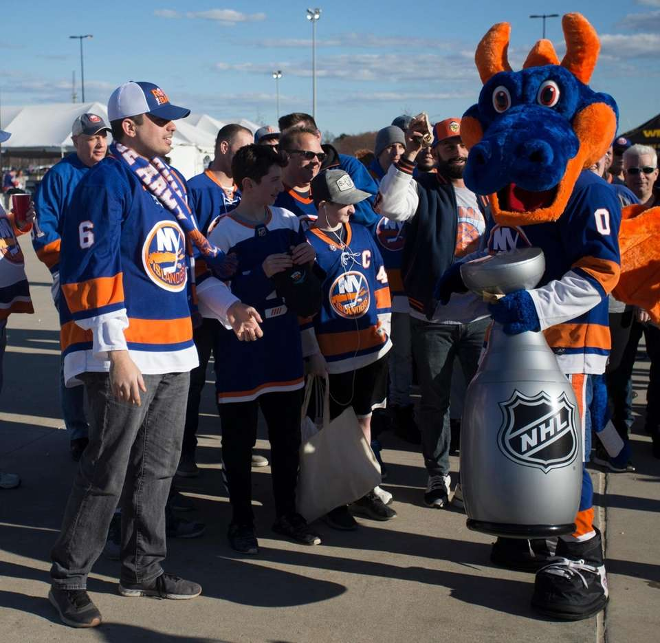 The Islanders mascot Sparky the Dragon is outside
