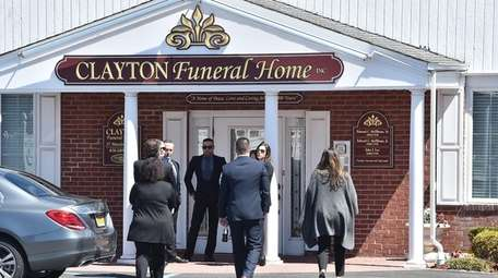 Mourners arrive at funeral services Wednesday for former