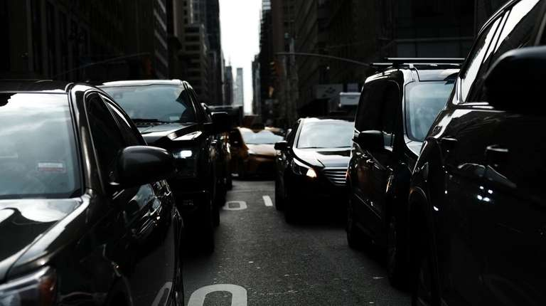 Cars pause in traffic on a busy Manhattan