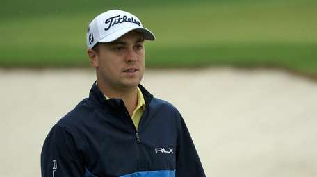 Justin Thomas looks on during a practice round