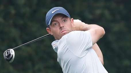 Rory McIlroy of Northern Ireland hits his tee