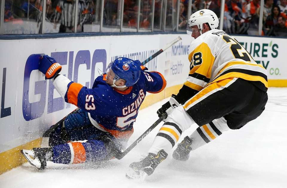 Islanders center Casey Cizikas gets tripped by Penguins