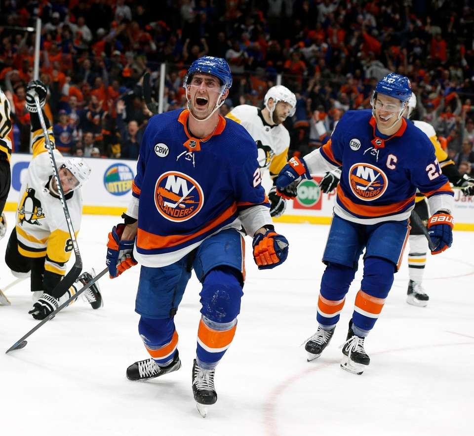 Islanders center Brock Nelson celebrates after he scores
