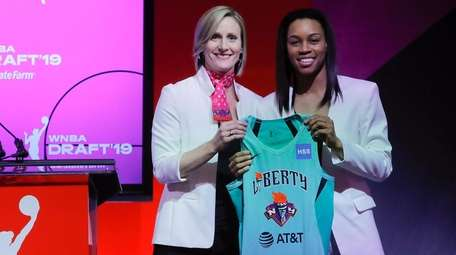 Louisville's Asia Durr, right, poses for photo with