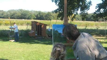 Max Moran assists a painter during last year's